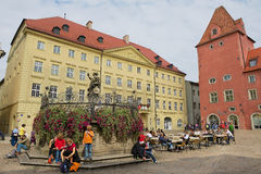 People enjoy time at the square of the historical part of Regensburg, Germany. Royalty Free Stock Photography