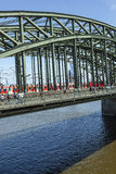 people enjoy to walk along the promenade at the Hohenzollern bridge Royalty Free Stock Image