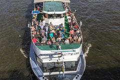 People enjoy the trip on river Main on a sunny day. FRANKFURT, GERMANY - OCT 28, 2013: people enjoy the trip on river Main on a sunny day. Many tourists do royalty free stock photography