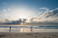 People enjoy tropical sunset on the beach Stock Images