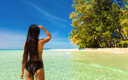 People enjoy vacation on tropical sandy beach on background sea water and blue sky Stock Images
