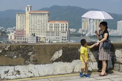 People enjoy the view to downtown Macau in Macau, China. Royalty Free Stock Photography