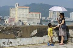 People enjoy the view to downtown Macau in Macau, China. MACAU, CHINA - SEPTEMBER 11, 2013: Unidentified people enjoy the view to downtown Macau on September 11 royalty free stock photography
