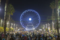 People enjoy visiting Christmas market with ferris wheel and ice Stock Photos