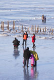 People enjoy a walk on the frozen Songhua river, Harbin, China. HARBIN-MARCH 7. City dwellers enjoy frozen Songhua River. Harbin is located Northeast China under Royalty Free Stock Images