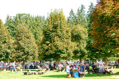 People enjoy warm late summer weather in park. Families enjoy the warm late summer weather for a picnic in a public park in Germany Royalty Free Stock Photos