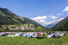 People enjoy windsurfing at lake Levico in Latsch Stock Photo
