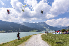 People enjoy windsurfing at lake Levico in Latsch Stock Image