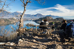 People enjoying aerial view from top hill on scenic lake bled royalty free stock photo