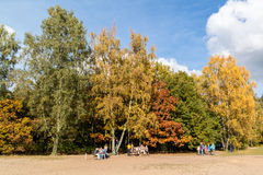 People enjoying autumn in Netherlands. DOORN, NETHERLANDS - OCT 25, 2015: People walking and relaxing in the woods on a sunny Sunday in autumn Royalty Free Stock Image