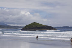 People enjoying the beach and surfing at Incinerator Rock. Pacific Rim National Park Stock Photos