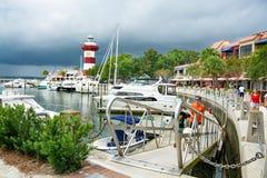 People enjoying beautiful Harbour Town Marina in South Carolina. Hilton Head Island, South Carolina,USA-Augus,25,2018. Beautiful view of The Harbour Town stock images