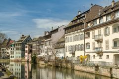 People enjoying beautiful sunny afternoon in Little France district in Strasbourg royalty free stock images