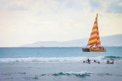 People enjoying being out on the water at Waikiki Beach. Stock Images