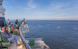 People enjoying the boat trip from Texel island to Den Helder ci. Ty in Holland stock image