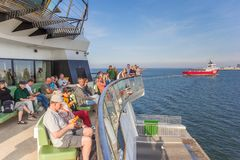 People enjoying the boat trip from Texel island to Den Helder city. In Holland stock photo
