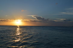 People Enjoying a Caribbean Sunset on a Little Boat, Split, Caye Caulker, Belize. People Enjoying a Caribbean Sunset on a Little Boat, just off the Split, Caye Stock Images