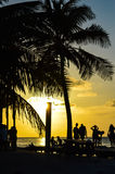 People Enjoying a Caribbean Sunset, Split, Caye Caulker, Belize Stock Photos