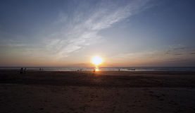 People Enjoying Casuarina Beach at Sunset, Darwin. Small Waves Wash on Beach, Casuarina Beach, Darwin - Sunset Stock Photos