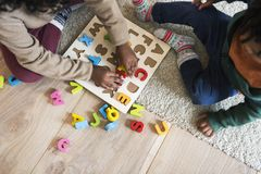 People enjoying Christmas holiday alphabets toy playing stock photography