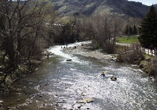 People having fun in Clear Creek in Golden CO Stock Photo