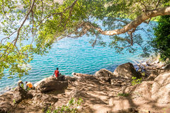 People enjoying clear water of Chala Lake on the border of Kenya Stock Images