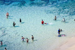 People enjoying the crystal clear waters at Hanauma Bay. Honolulu, Hawaii, USA - May 29, 2016: People enjoying the crystal clear waters at Hanauma Bay Nature Royalty Free Stock Photography