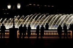 People enjoying dancing waters in Las Vegas. A random night in Las Vegas with dancing waters on the background royalty free stock photography