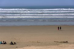 People enjoying a day at a beach Oregon royalty free stock images