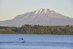 People enjoying and doing sports in the lake of Puerto Varas, Chile. People enjoying and doing sports in the lake Todo los Santos stock photography