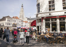 People enjoying a drink on the market near breda cathedral Royalty Free Stock Image