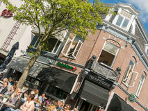 People having drinks on outdoor terrace of cafe, Holland Stock Photo