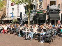People enjoying drinks on outdoor terrace of cafe in Hilversum, Royalty Free Stock Photo