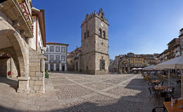 People enjoying the esplanades in the Oliveira Square. Guimaraes, Portugal - October, 2015: People enjoying the esplanades in the Oliveira Square with the Nossa royalty free stock images