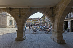 People enjoying the esplanades in the Oliveira Square Stock Image