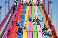 People enjoying a giant slide Stock Image