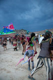 People enjoying and holding flags during the opening party Royalty Free Stock Photos