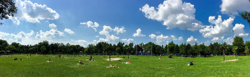 People Enjoying Hot Summer Weather And Getting Tanned In Tineretului Park Of Bucharest City Royalty Free Stock Photo