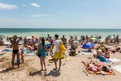 People Enjoying Hot Weather On Beach Stock Image