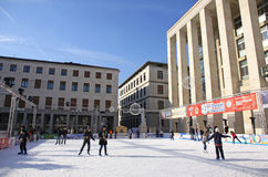 People enjoying ice skating rink stock images