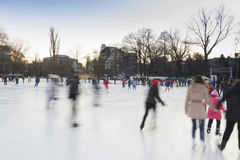People enjoying ice skating rink Royalty Free Stock Image