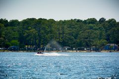 People Enjoying with Jet Boating at Sea in Florida. On Blur Background stock images