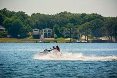 People Enjoying with Jet Boating at Sea in Florida. On Blur Background royalty free stock photos