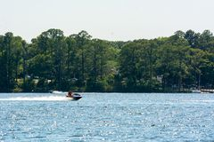 People Enjoying with Jet Boating at Sea in Florida. On Blur Background stock photos