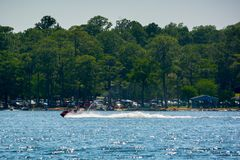 People Enjoying with Jet Boating at Sea in Florida. On Blur Background stock image