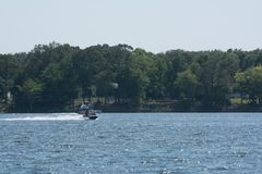 People Enjoying with Jet Boating at Sea in Florida. On Blur Background stock photography