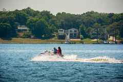 People Enjoying with Jet Boating at Sea in Florida. On Blur Background royalty free stock photo