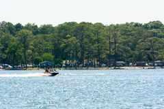 People Enjoying with Jet Boating at Sea in Florida. On Blur Background royalty free stock image