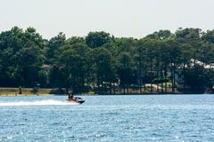 People Enjoying with Jet Boating at Sea in Florida. On Blur Background stock photo