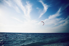 People enjoying kitesurfing on clear  tropical water Royalty Free Stock Images